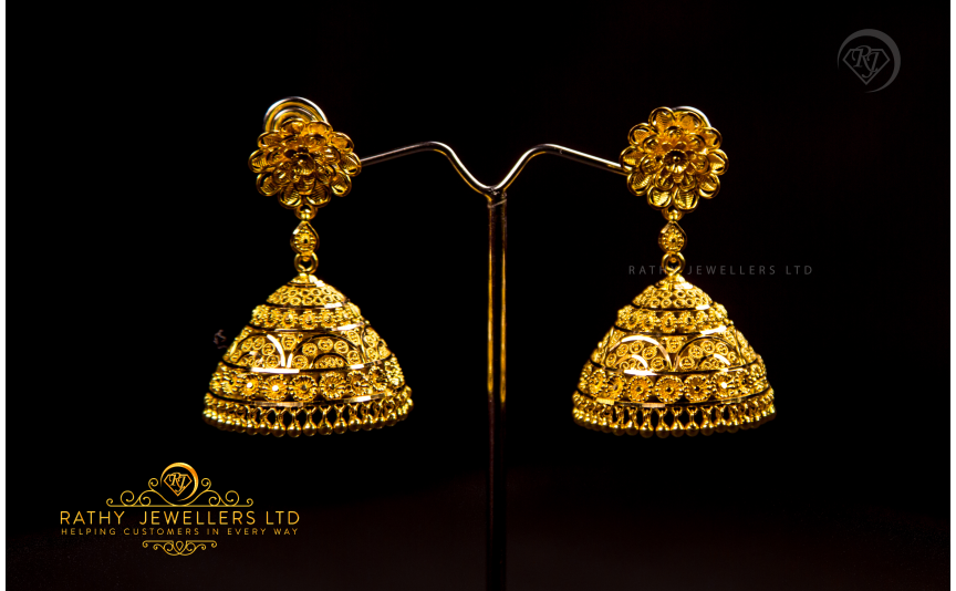 EARRING. Huge range of collection of Earrings from Studs to Drops and Jhumkas.